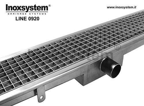 Channels with standard grating with low profile rectangular floor drain, odor trap and removable filter basket. LINE 0920